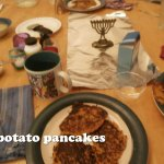Chanukah table with potato pancakes
