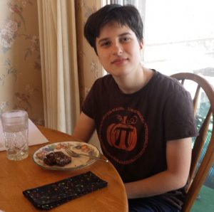 My son James, wearing a Pumpkin Pi shirt and eating Pi Pie. :)