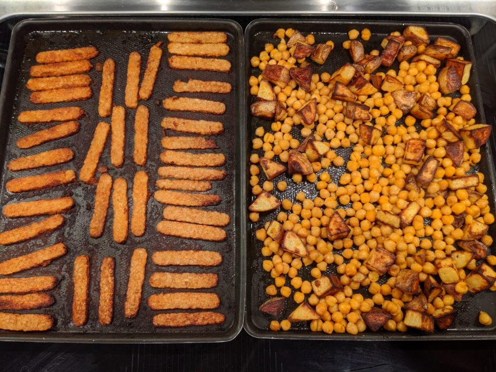 Finished tempeh on the left, looking golden. Finished potatoes and chickpeas on the right, with the potatoes also looking golden.