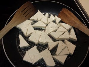 Tofu triangles before cooking