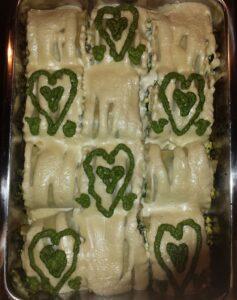 many green lasagna rolls